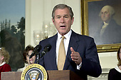 United States President George W. Bush announces his tax cut plan to a group of families in the Diplomatic Room of the White House in Washington, DC on February 5, 2001.<br /> Credit: Ron Sachs / CNP