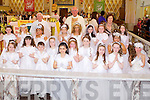Pupils from Scoil Mhaithair De who received their 1st holy communion communion, pictured here last Saturday with Fr Stanley, Fr O'Shea and Mrs Gleeson in the Church of The Assumption, Abbeyfeale