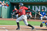 Yeison Melo (23) of the Idaho Falls Chukars  follows through on his swing against the Ogden Raptors during the Pacific Coast League game at Smith's Ballpark on August 29, 2016 in Salt Lake City, Utah. The Chukars defeated the Raptors 3-0. (Stephen Smith/Four Seam Images)
