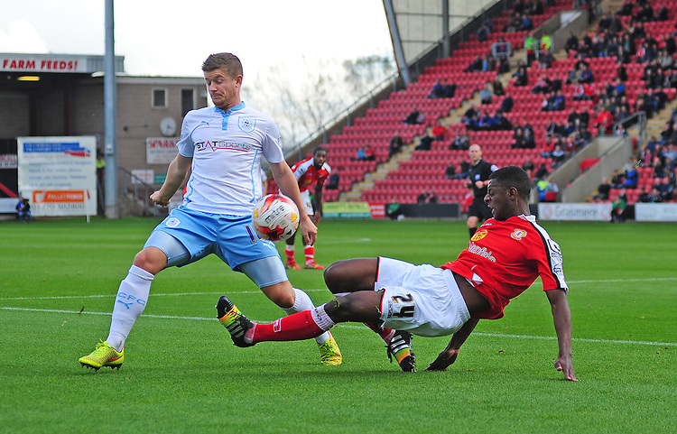 Coventry City's Aaron Phillips vies for possession with Crewe Alexandra's Greg Leigh<br /> <br /> Photographer Chris Vaughan/CameraSport<br /> <br /> Football - The Football League Sky Bet League One - Crewe Alexandra v Coventry City - Saturday 11th October 2014 - Alexandra Stadium - Crewe<br /> <br /> &copy; CameraSport - 43 Linden Ave. Countesthorpe. Leicester. England. LE8 5PG - Tel: +44 (0) 116 277 4147 - admin@camerasport.com - www.camerasport.com