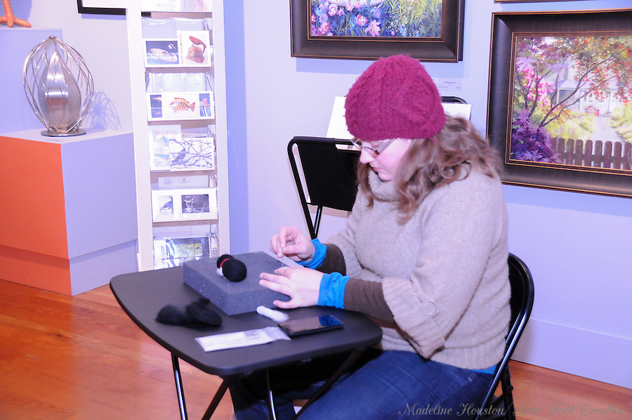 Artist Amanda Haanson works on a needle felting project at the Rectangle Gallery. <br />