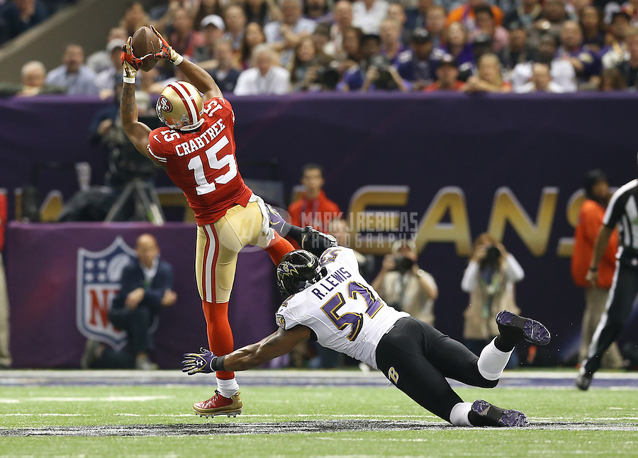 Feb 3, 2013; New Orleans, LA, USA; San Francisco 49ers wide receiver Michael Crabtree (15) catches a pass over Baltimore Ravens inside linebacker Ray Lewis (52) in the first quarter in Super Bowl XLVII at the Mercedes-Benz Superdome. Mandatory Credit: Mark J. Rebilas-