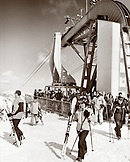USA, Utah, skiers getting off of the tram, Snowbird Ski Resort (B&W)