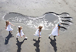 Gulliver Travels Once More.  A group of five year olds, Sophie Kirwan, Ella King, Sophie Gannon and  Leah Etherington discovered a giant footstep in Sandymount Strand, sources have confirmed it belongs to Gulliver who has returned to guide debate on the recession in this year's Swift Festival in Trim running from the 2nd to the 5th of July. Pic Robbie Reynolds