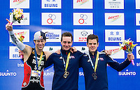 10 SEP 2011 - BEIJING, CHN - Alistair Brownlee (GBR) (centre) celebrates winning the 2011 Elite Mens ITU World Championship Series Grand Final Triathlon, flanked by silver medalist Sven Riederer (SUI) (left) and bronze medalist Jonathan Brownlee (GBR). The victory in a time of 1:48:06 also gave him the World Championship Series title (PHOTO (C) NIGEL FARROW)