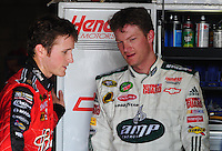 Aug 30, 2008; Fontana, CA, USA; NASCAR Sprint Cup Series driver Kasey Kahne (left) talks with Dale Earnhardt Jr during practice for the Pepsi 500 at Auto Club Speedway. Mandatory Credit: Mark J. Rebilas-