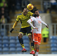 Blackpool's Kelvin Mellor jumps with  Oxford United's Wes Thomas<br /> <br /> Photographer Mick Walker/CameraSport<br /> <br /> The EFL Sky Bet League One - Oxford United v Blackpool - Saturday 6th January 2018 - Kassam Stadium - Oxford<br /> <br /> World Copyright &copy; 2018 CameraSport. All rights reserved. 43 Linden Ave. Countesthorpe. Leicester. England. LE8 5PG - Tel: +44 (0) 116 277 4147 - admin@camerasport.com - www.camerasport.com