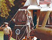 United States President Jimmy Carter waves from Marine One as he boards Marine One at Camp David, the presidential retreat near Thurmont, Maryland, on July 12, 1979.  The President was traveling to Pittsburg, Pennsylvania to meet the Fisher Family to discuss issues facing the nation.  He returned to Camp David later in the day.<br /> Mandatory Credit: Bill Fitz-Patrick / White House via CNP