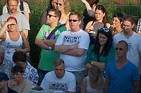 """Auf einer Buergerversammlung mit ca. 500 Teilnehmern im Berliner Plattenbaubezirk Hellersdorf entlud sich am Dienstag den 9. Juli 2013 der blanker Rassismus gegen eine geplante Unterkunft fuer syrische Buergerkriegsfluechlinge. Etwa 2/3 Anwesende aeusserten, es solle """"zuerst was fuer Deutsche getan werden"""", """"das Heim anzuenden"""", """"Wer sein Heimatland verlaesst ist ein Verraeter"""", """"Wer denkt an unsere Kinder"""" und aehnliche Parolen gegen das Fluechtlingsheim. Veranstaltungsteilnehmer, die Verstaendnis fuer die Buergerkriegsfluechtlinge aeusserten, wurden niedergebruellt.<br />Im Bild: Veranstaltungsteilnehmer mit T-Shirts mit dem Aufdruck """"Nein zum Heim"""", die von einer anonymen Buergerinitiative verteilt werden.<br />9.7.2013, Berlin<br />Copyright: Christian-Ditsch.de<br />[Inhaltsveraendernde Manipulation des Fotos nur nach ausdruecklicher Genehmigung des Fotografen. Vereinbarungen ueber Abtretung von Persoenlichkeitsrechten/Model Release der abgebildeten Person/Personen liegen nicht vor. NO MODEL RELEASE! Don't publish without copyright Christian-Ditsch.de, Veroeffentlichung nur mit Fotografennennung, sowie gegen Honorar, MwSt. und Beleg. Konto:, I N G - D i B a, IBAN DE58500105175400192269, BIC INGDDEFFXXX, Kontakt: post@christian-ditsch.de<br />Urhebervermerk wird gemaess Paragraph 13 UHG verlangt.]"""
