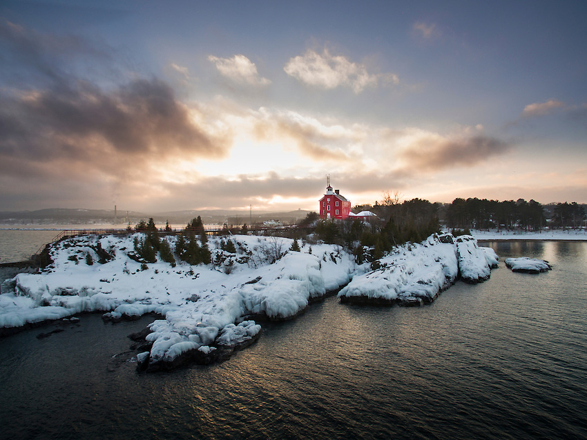 Aerial view of the red Marquette Lighthouse on Lake Superior in Marquette, Michigan.