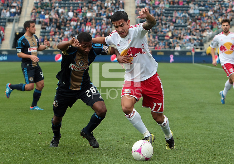 CHESTER, PA - OCTOBER 27, 2012:  Raymon Gaddis (28) of the Philadelphia Union struggles against  Tim Cahill (17) of the New York Red Bulls during an MLS match at PPL Park in Chester, PA. on October 27. Red Bulls won 3-0.
