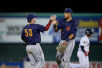 State College Spikes third baseman Brylie Ware (53) high fives first baseman Dariel Gomez (34) after a NY-Penn League game against the Mahoning Valley Scrappers on August 29, 2019 at Eastwood Field in Niles, Ohio.  State College defeated Mahoning Valley 8-1.  (Mike Janes/Four Seam Images)