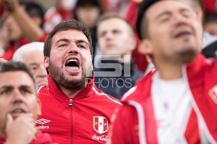 YEKATERINBURG, RUSSIA - June 21, 2018:  A Peru fan cheers on his team during the Peru vs. France  2018 FIFA World Cup group stage at Yekaterinburg Arena Stadium.