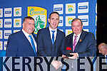 The recently retired Declan O'Sullivan receives his sixth  All Ireland Meda from GAA President Liam O'Neill and County board chairman Patrick O'Sullivan at their victory banquet in the INEC on Friday night