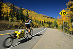A mountain biker rides over Red Mountain Pass in the San Juan Mountains of Colorado.