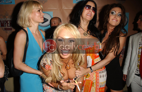 Rena Riffel and Marey Carey with Joanie Laurer and Jessica James<br />