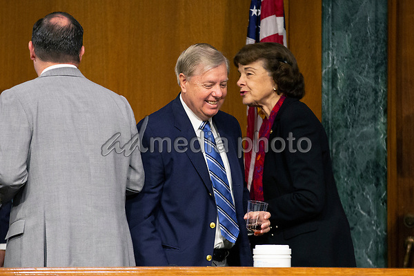 United States Senator Dianne Feinstein (Democrat of California) speaks to United States Senator Lindsey Graham (Republican of South Carolina) as they depart a business meeting of the United States Senate Judiciary Committee at the United States Capitol in Washington D.C., U.S. on Thursday, May 21, 2020.  Credit: Stefani Reynolds / CNP/AdMedia