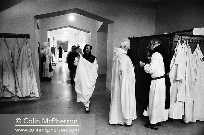 Monks disrobing after evening prayers in the chapel at Sancta Maria Abbey at Nunraw, East Lothian, home since 1946 to the Order of Cistercians of the Strict Observance. Around 15 monks were resident at Nunraw in 1996, undertaking a mixture of daily tasks and strict religious observance. The present purpose-built building dates from 1969 when the monks moved from the nearby Nunraw house.