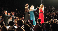 Viviana G, designer of Petit Pois, walks the runway after showing her fall/winter collections during opening nite of the 15th anniversary Miami Beach International Fashion Week, Miami Beach Convention Center, South Beach, Florida, USA, March 20, 2013. Photo by Debi Pittman Wilkey
