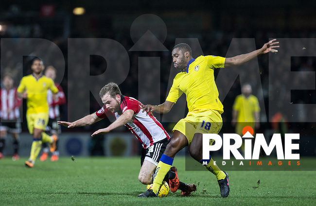 Mustapha Carayol of Leeds United brings down Alan Judge of Brentford during the Sky Bet Championship match between Brentford and Leeds United at Griffin Park, London, England on 26 January 2016. Photo by Andy Rowland / PRiME Media Images.