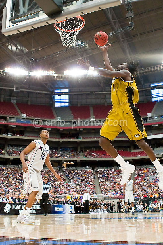 Mar 28, 2009; Glendale, AZ, USA; Missouri Tigers forward DeMarre Carroll (1) lays the ball up in front of Connecticut Huskies guard A.J. Price (12) in the first half of a game in the finals of the west region of the 2009 NCAA basketball tournament at University of Phoenix Stadium.  The Huskies defeated the Tigers 82-75 to advance to the Final Four.