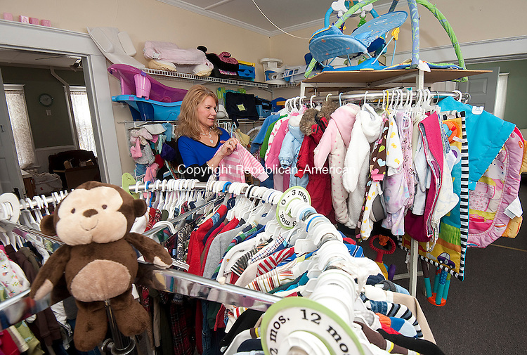 CHESHIRE  CT-022715JS08- Therese Ritchie, center director at Hope Pregnancy Center in Cheshire organizes items in their thrift store on Friday. The center will be celebrating its 30th anniversary with a gala on March 19 at Aria Wedding &amp; Banquet Facility by Villa Rosa in Prospect. <br /> Jim Shannon Republican-American