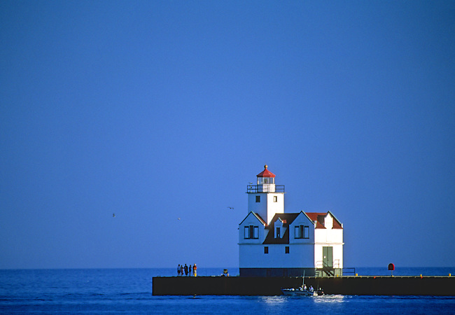 The Kewauneee Pierhead lighthouse is framed by an afternoon blue sky, Lake Michigan, Kewaunee, Kewaunee County, Wisconsin.