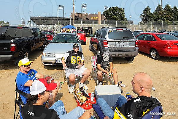 September 7, 2009; Hamilton, ON, CAN; CFL football fans tailgate on the grounds of Scott Park school before the Labour Day Classic game between the Toronto Argonauts and Hamilton Tiger-Cats at Ivor Wynne Stadium. The Tiger-Cats defeated the Argos 34-15. Mandatory Credit: Ron Scheffler.
