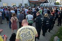 """Auf einer Buergerversammlung mit ca. 500 Teilnehmern im Berliner Plattenbaubezirk Hellersdorf entlud sich am Dienstag den 9. Juli 2013 der blanker Rassismus gegen eine geplante Unterkunft fuer syrische Buergerkriegsfluechlinge. Etwa 2/3 Anwesende aeusserten, es solle """"zuerst was fuer Deutsche getan werden"""", """"das Heim anzuenden"""", """"Wer sein Heimatland verlaesst ist ein Verraeter"""", """"Wer denkt an unsere Kinder"""" und aehnliche Parolen gegen das Fluechtlingsheim. Veranstaltungsteilnehmer, die Verstaendnis fuer die Buergerkriegsfluechtlinge aeusserten, wurden niedergebruellt.<br />Im Bild: Vorne, ein Neonazi mit einem T-Shirt der in der Szene beliebten Mordemarke Thor Steinar.<br />9.7.2013, Berlin<br />Copyright: Christian-Ditsch.de<br />[Inhaltsveraendernde Manipulation des Fotos nur nach ausdruecklicher Genehmigung des Fotografen. Vereinbarungen ueber Abtretung von Persoenlichkeitsrechten/Model Release der abgebildeten Person/Personen liegen nicht vor. NO MODEL RELEASE! Don't publish without copyright Christian-Ditsch.de, Veroeffentlichung nur mit Fotografennennung, sowie gegen Honorar, MwSt. und Beleg. Konto:, I N G - D i B a, IBAN DE58500105175400192269, BIC INGDDEFFXXX, Kontakt: post@christian-ditsch.de<br />Urhebervermerk wird gemaess Paragraph 13 UHG verlangt.]"""