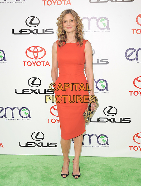 Kyra Sedgwick.attends The 21st Annual Environmental Media Awards held at at Warner Bros. Studios in Burbank, California, USA, October 15th 2011..full length red dress gold black print clutch bag   hand in pocket open toe shoes .CAP/RKE/DVS.©DVS/RockinExposures/Capital Pictures.