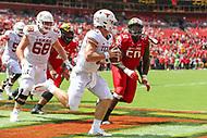 Landover, MD - September 1, 2018: Texas Longhorns quarterback Sam Ehlinger (11) scrambles during the game between Texas and Maryland at  FedEx Field in Landover, MD.  (Photo by Elliott Brown/Media Images International)