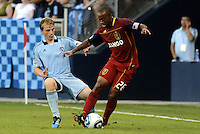 Sporting KC defender Seth Sinovic, (pale blue) keeps his eyes on Collen Warner Real Salt Lake... Sporting Kansas City defeated Real Salt Lake 2-0 at LIVESTRONG Sporting Park, Kansas City, Kansas.