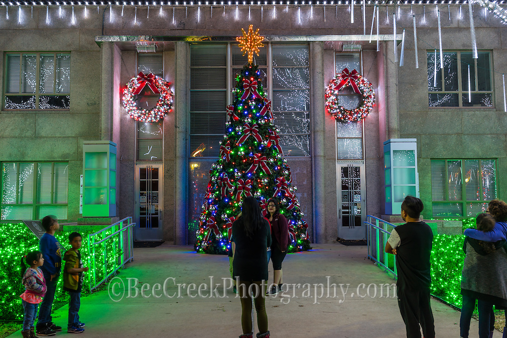 People gather at the Burnet Court house to take in the Christmas Tree and lights. The light display is great the trees seem to drip the white light on all the trees.