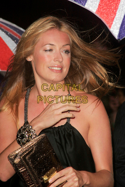 CAT DEELEY.The Pride of Britain Awards, London Television Centre, South Bank, London, England, UK, .September 30th, 2008 .half length hand bracelet gold clutch bag black dress .CAP/AH.©Adam Houghton/Capital Pictures.