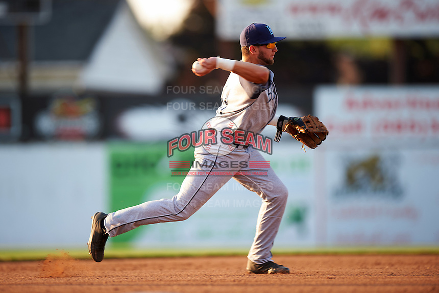 Brooklyn Cyclones third baseman Blake Tiberi (11) throws to first during a game against the Batavia Muckdogs on July 5, 2016 at Dwyer Stadium in Batavia, New York.  Brooklyn defeated Batavia 5-1.  (Mike Janes/Four Seam Images)
