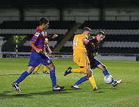 Dale Shirkin (centre) being stopped by Paul Dummit watched by Mo Yarqub in the St Mirren v Motherwell Clydesdale Bank Scottish Premier League U20 match played at St Mirren Park, Paisley on 10.9.12.