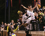 8 December 2007: Wake Forest players Austin da Luz (shirtless), Cody Arnoux (17) and Ike Opara (23) celebrate with the fans in the stands after da Luz's overtime goal secured the victory. Wake Forest University defeated Notre Dame University 1-0 in overtime at Spry Stadium in Winston-Salem, NC in an NCAA Men's Soccer tournament quarterfinal.