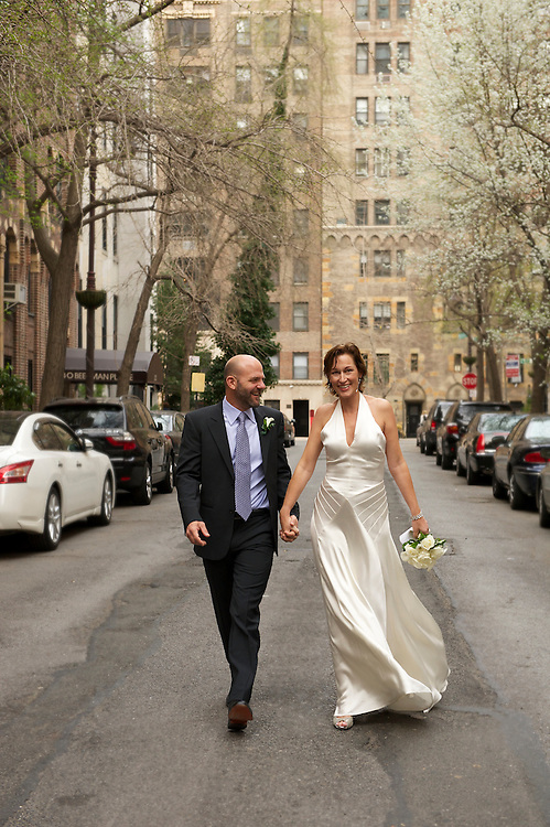 Bride and groom walking down the street at Beekman Place in Manhattan.