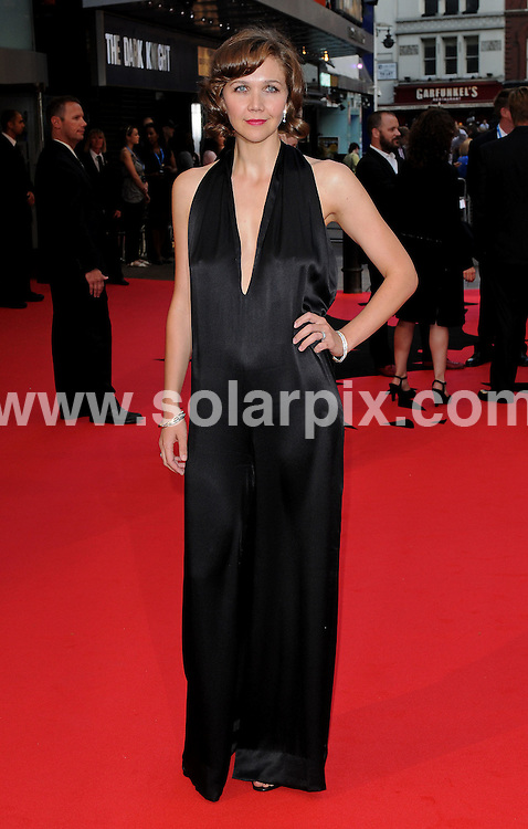 **ALL ROUND PICTURES FROM SOLARPIX.COM**.**WORLDWIDE SYNDICATION RIGHTS**.The Red carpet arrivals at the European Premiere of The Dark Knight  Held at the Odeon in Leicester Square in London..This pic:Maggie Gyllenhall..JOB REF: 6887-SSD     DATE:21_07_08.**MUST CREDIT SOLARPIX.COM OR DOUBLE FEE WILL BE CHARGED* *UNDER NO CIRCUMSTANCES IS THIS IMAGE TO BE REPRODUCED FOR ANY ONLINE EDITION WITHOUT PRIOR PERMISSION*