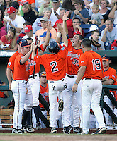 Virginia's Keith Werman (2) goes for a high-five from a much taller Kenny Swab (35) after scoring in the sixth inning. Virginia beat Cal 8-1 at the College World Series on June 23, 2011 in Omaha, Neb. (Photo by Michelle Bishop)..
