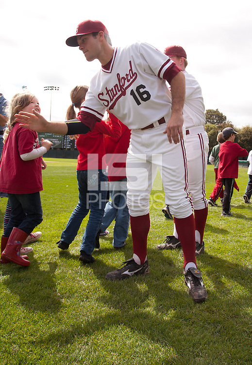 STANFORD, CA - March 27, 2011: Jordan Pries of Stanford baseball gives high-fives to singers from Addison Elementary before Stanford's game against Long Beach State at Sunken Diamond. Stanford won 6-5.