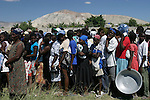 February 17, 2004. Gonaive, Haiti. People of Gonaive wait on line for food to be handed out during the rebel crisis.