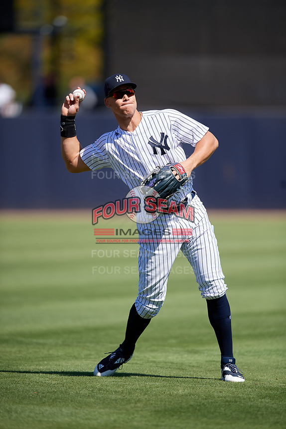 New York Yankees right fielder Aaron Judge (99) warms up before a Grapefruit League Spring Training game against the Toronto Blue Jays on February 25, 2019 at George M. Steinbrenner Field in Tampa, Florida.  Yankees defeated the Blue Jays 3-0.  (Mike Janes/Four Seam Images)