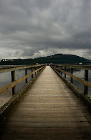 Wooden Jetty stretching over the water close to. Deep Cove, North Vancouver, British Columbia, Canada.
