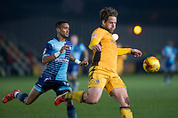 Darren Jones of Newport County clears from Paris Cowan-Hall of Wycombe Wanderers during the Sky Bet League 2 match between Newport County and Wycombe Wanderers at Rodney Parade, Newport, Wales on 22 November 2016. Photo by Mark  Hawkins.