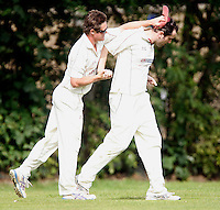 Craig Gourlay (L) mobs Ed Binns of Highgate after he made a catch during the Middlesex County League Division Three game between Highgate and Bessborough at Park Road, Crouch End on Sat Sept 4, 2010