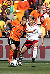 14 JUN 2010:  Rafael van der Vaart (NED)(23) tries to shield the ball from Christian Poulsen (DEN)(2).  The Netherlands National Team defeated the Denmark National Team 2-0 at Soccer City Stadium in Johannesburg, South Africa in a 2010 FIFA World Cup Group E match.