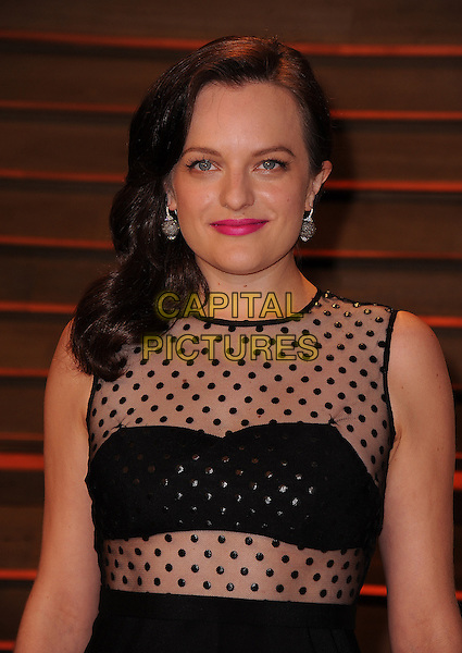 WEST HOLLYWOOD, CA - MARCH 2: Elisabeth Moss arrives at the 2014 Vanity Fair Oscar Party in West Hollywood, California on March 2, 2014.  <br /> CAP/MPI/MPI213<br /> &copy;MPI213/MediaPunch/Capital Pictures