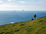 Valentia Lifeboat passes The Skellig Rocks as a walker takes a stroll on Bray Head in County Kerry, Ireland<br /> Photo: Don MacMonagle<br />  <br /> e: info@macmonagle.com