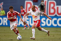 NY Red Bulls midfielder (13) Clint Mathis is chased by Chicago Fire midfielder (7) Logan Pause. The Red Bulls defeated the Chicago Fire 3-0 at Giants Stadium, East Rutherford, NJ, on May 24, 2007.